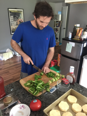 Ronnie shows off his chopping skills as he prepares green peppers from his garden.